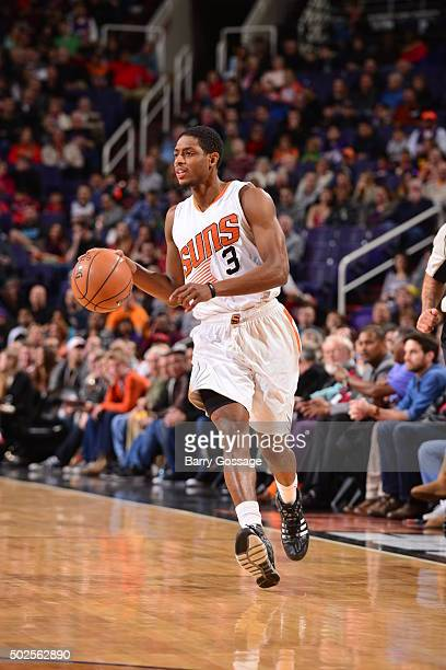 Brandon Knight of the Phoenix Suns dribbles the ball against the Philadelphia 76ers on December 26 2015 at Talking Stick Resort Arena in Phoenix...