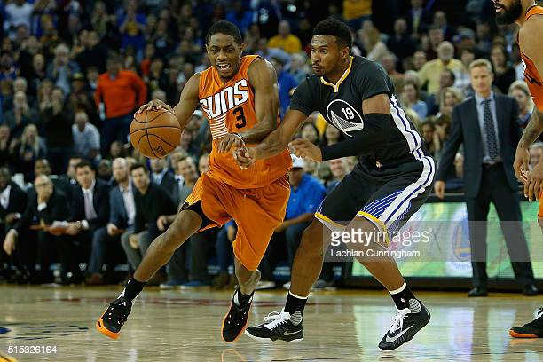 Brandon Knight of the Phoenix Suns drives past Leandro Barbosa of the Golden State Warriors at ORACLE Arena on March 12 2016 in Oakland California...