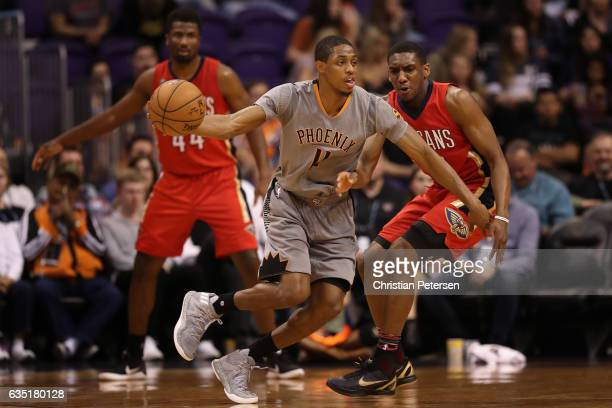 Brandon Knight of the Phoenix Suns drives the ball past Langston Galloway of the New Orleans Pelicans during the first half of the NBA game at...