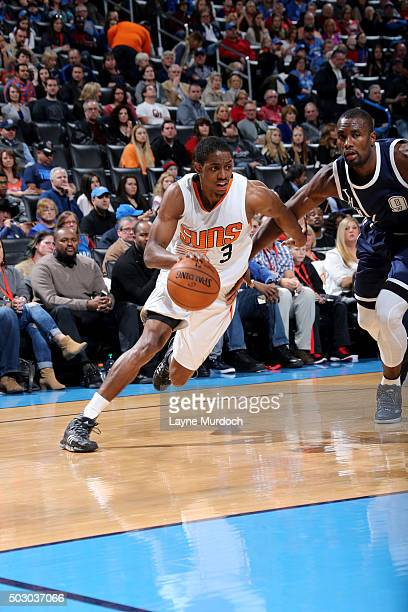 Brandon Knight of the Phoenix Suns drives to the basket against the Oklahoma City Thunder on December 31 2015 at Chesapeake Energy Arena in Oklahoma...
