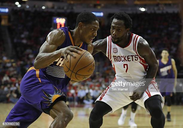 Brandon Knight of the Phoenix Suns drives to the basket with Patrick Beverley of the Houston Rockets defending in the first half at Toyota Center on...