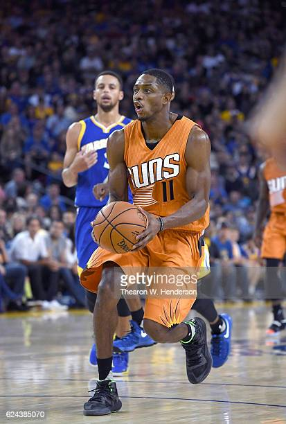 Brandon Knight of the Phoenix Suns drives with the ball towards the basket against the Golden State Warriors during an NBA basketball game at ORACLE...