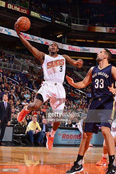 Brandon Knight of the Phoenix Suns goes for the layup against Ryan Anderson of the New Orleans Pelicans during the game on November 25 2015 at...