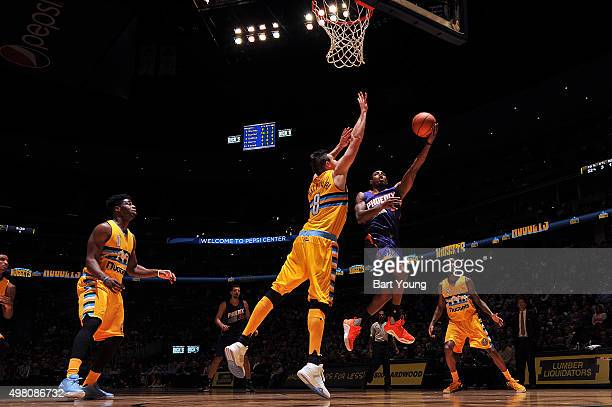 Brandon Knight of the Phoenix Suns goes to the basket against Danilo Gallinari of the Denver Nuggets on November 20 2015 at the Pepsi Center in...