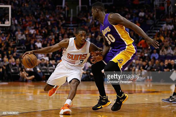 Brandon Knight of the Phoenix Suns handles the ball under pressure from Julius Randle of the Los Angeles Lakers during the second half of the NBA...