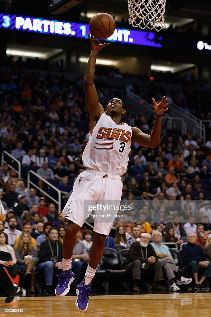 Brandon Knight #3 of the Phoenix Suns lays up a shot against the Denver Nuggets during the second half of the NBA game at Talking Stick Resort Arena on December 23, 2015 in Phoenix, Arizona. The Nuggets defeated the Suns 104-96.