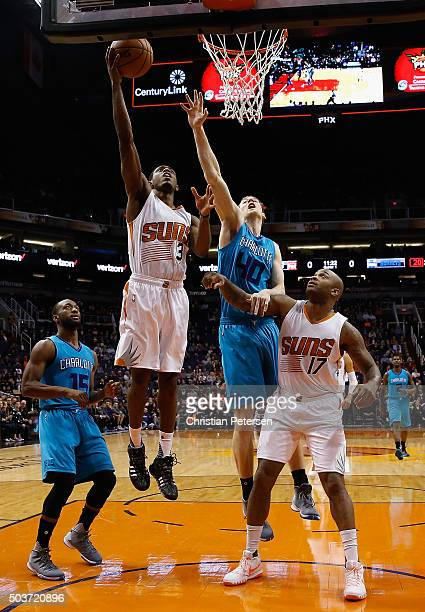 Brandon Knight of the Phoenix Suns lays up a shot past Cody Zeller of the Charlotte Hornets during the first half of the NBA game at Talking Stick...