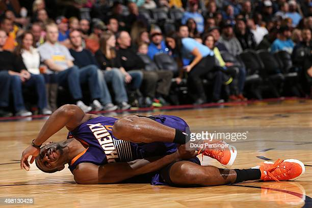 Brandon Knight of the Phoenix Suns reacts as he falls to the court after an injury against the Denver Nuggets at Pepsi Center on November 20 2015 in...