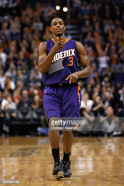 Brandon Knight of the Phoenix Suns reacts to a three point shot against the Cleveland Cavaliers during the NBA game at Talking Stick Resort Arena on...