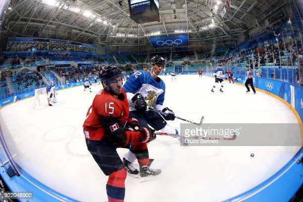 Brandon Kozun of Canada competes for the puck with Miro Heiskanen of Finland in the first period during the Men's Playoffs Quarterfinals on day...