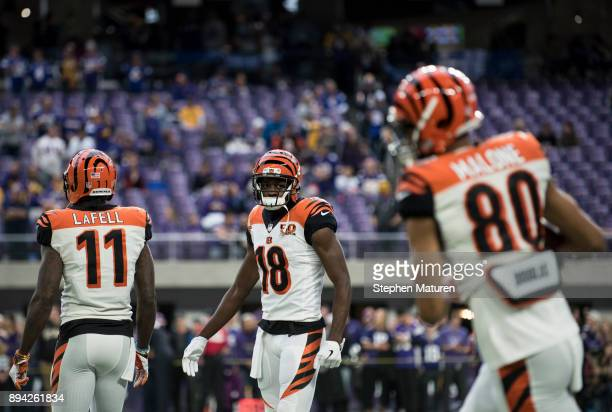 Brandon LaFell, A.J. Green, and Josh Malone of the Cincinnati Bengals warm up before the game against the Minnesota Vikings on December 17, 2017 at...