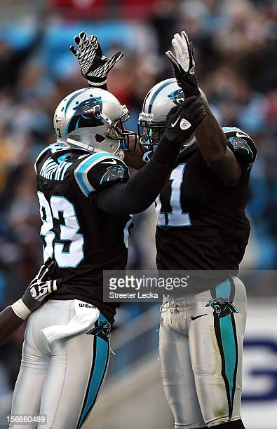 Brandon LaFell of the Carolina Panthers celebrates after scoring a touchdown with teammate Louis Murphy during their game against the Tampa Bay...
