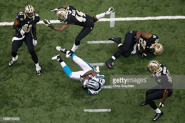 Brandon LaFell of the Carolina Panthers makes a reception against the New Orleans Saints at the MercedesBenz Superdome on December 30 2012 in New...