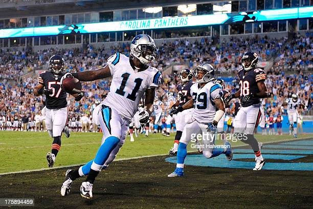 Brandon LaFell of the Carolina Panthers scores a touchdown against the Chicago Bears during a preseason NFL game at Bank of America Stadium on August...