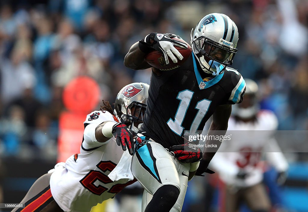 Brandon LaFell #11 of the Carolina Panthers scores a touchdown as Mark Barron #24 of the Tampa Bay Buccaneers tries to make a tackle during their game at Bank of America Stadium on November 18, 2012 in Charlotte, North Carolina.