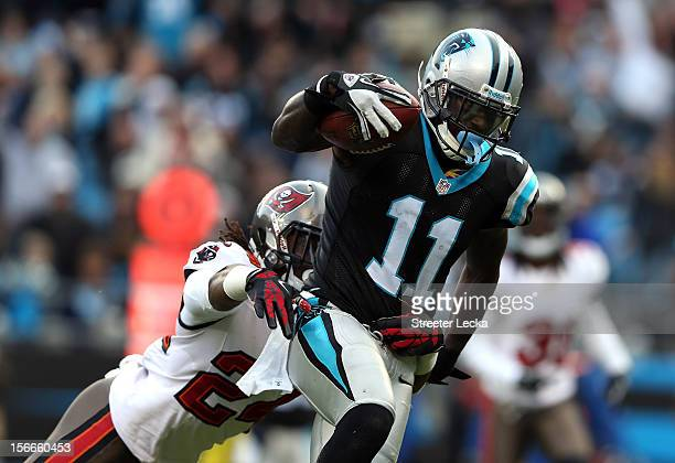 Brandon LaFell of the Carolina Panthers scores a touchdown as Mark Barron of the Tampa Bay Buccaneers tries to make a tackle during their game at...