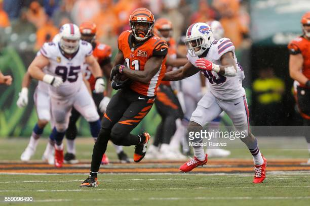 Brandon LaFell of the Cincinnati Bengals runs the ball upfield away from Shareece Wright of the Buffalo Bills during the fourth quarter at Paul Brown...