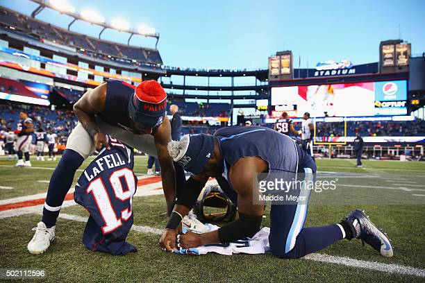 Brandon LaFell of the New England Patriots and Brian Orakpo of the Tennessee Titans exchange jerseys after their game at Gillette Stadium on December...