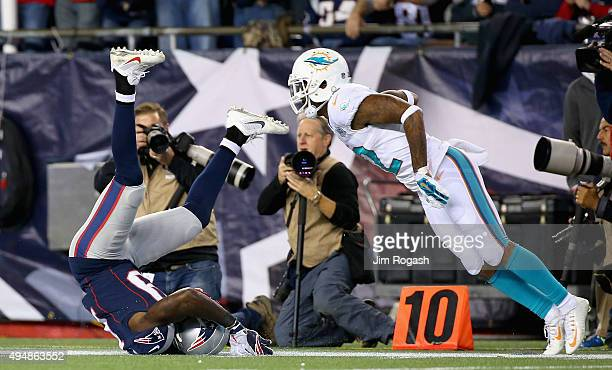 Brandon LaFell of the New England Patriots drops a pass as Jamar Taylor of the Miami Dolphins defends during the second quarter at Gillette Stadium...