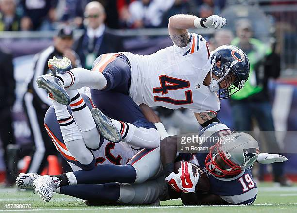 Brandon LaFell of the New England Patriots is tackled by Chris Conte of the Chicago Bears during the third quarter at Gillette Stadium on October 26...