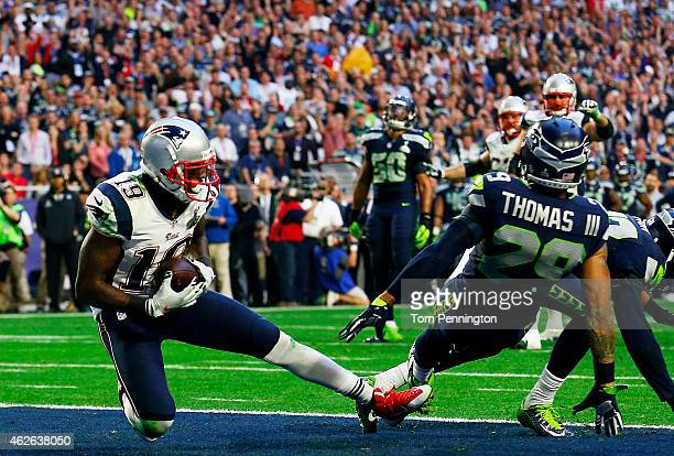 Brandon LaFell of the New England Patriots scores a touchdown over Earl Thomas of the Seattle Seahawks in the second quarter during Super Bowl XLIX...