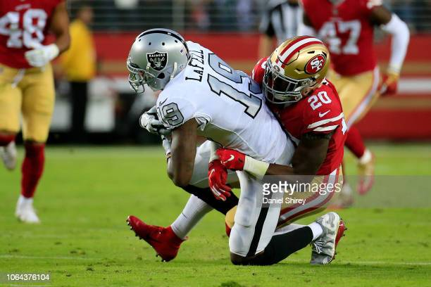 Brandon LaFell of the Oakland Raiders is tackled by Jimmie Ward of the San Francisco 49ers at Levi's Stadium on November 1, 2018 in Santa Clara,...