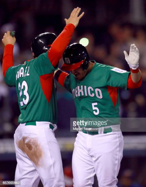 Brandon Laird of Mexico celebrates after hits a home run in the top of the fifth inning during the World Baseball Classic Pool D Game 6 between...