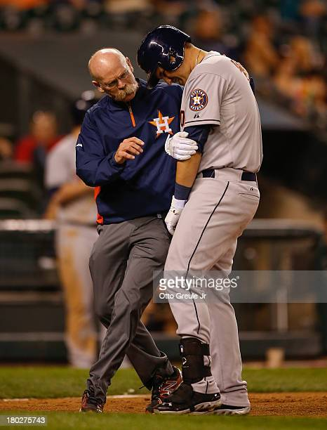 Brandon Laird of the Houston Astros is tended to by a trainer after being hit by a pitch in the eighth inning against the Seattle Mariners at Safeco...