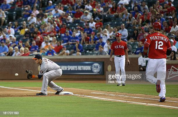 Brandon Laird of the Houston Astros makes the catch for the out on first base against AJ Pierzynski of the Texas Rangers in the first inning at...