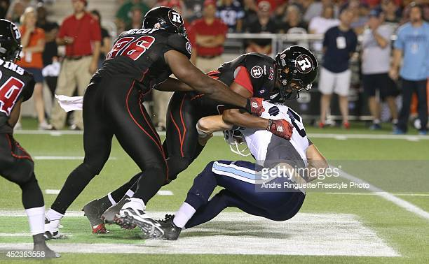 Brandon Lang of the Ottawa Redblacks sacks Ricky Ray of the Toronto Argonauts with support from teammate Chris McCoy during a CFL game at TD Place...