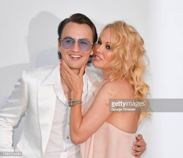 Brandon Lee and Pamela Anderson attend the amfAR Cannes Gala 2019 at Hotel du CapEdenRoc on May 23 2019 in Cap d'Antibes France
