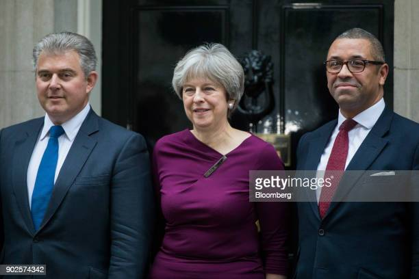 Brandon Lewis incoming chairman of the Conservative Party left Theresa May UK prime minister center and James Cleverly incoming deputy chairman of...