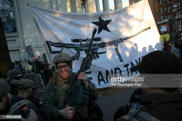 Brandon Lewis of Bergen New York carries a Barrett M82A1 through the streets before a progun rally near the Capitol Monday January 20 2020 in...