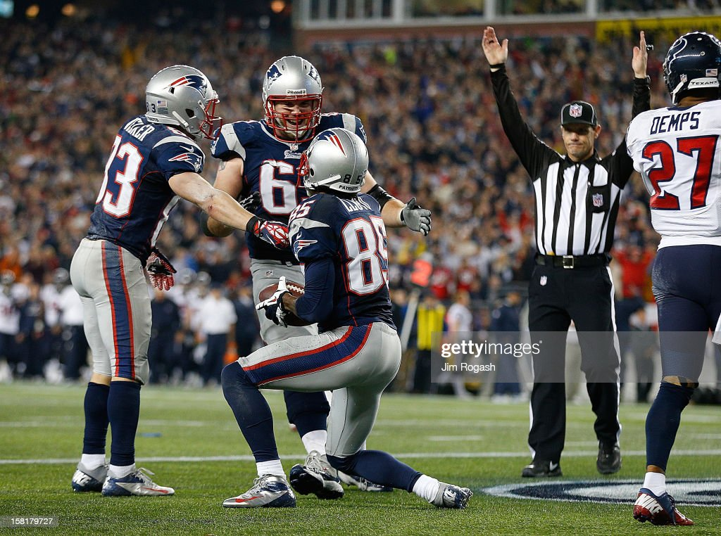 Brandon Lloyd #85 celebrates his touchdown with Wes Welker #83 and Dan Connolly #63 of the New England Patriots against the Houston Texans in the fourth quarter at Gillette Stadium on December 10, 2012 in Foxboro, Massachusetts. Lloyd scored when he picked up a ball fumbled by teammate Danny Woodhead #39 of the New England Patriots.