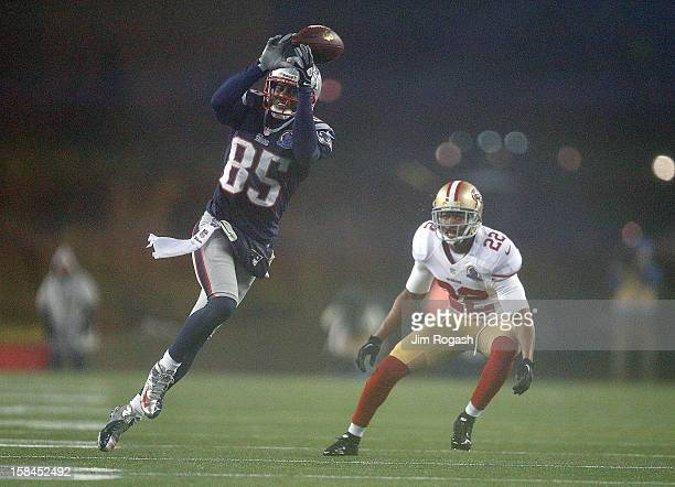 Brandon Lloyd of the New England Patriots is unable to catch a pass under the pressure of Carlos Rogers of the San Francisco 49ers in the first half...