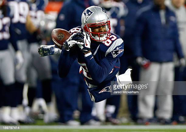 Brandon Lloyd of the New England Patriots misses a catch against the Baltimore Ravens during the 2013 AFC Championship game at Gillette Stadium on...