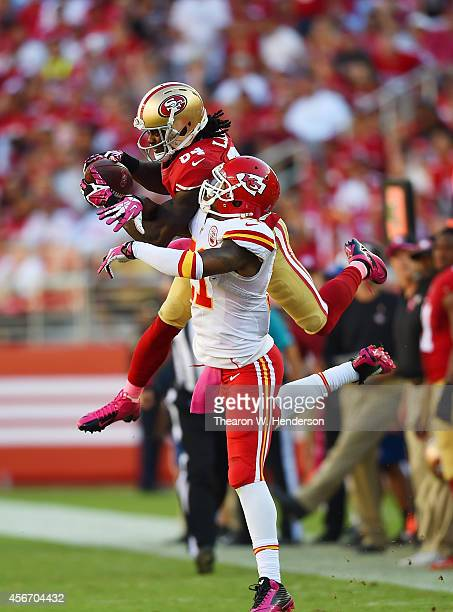 Brandon Lloyd of the San Francisco 49ers catches a 29yard pass over Sean Smith of the Kansas City Chiefs during the fourth quarter at Levi's Stadium...