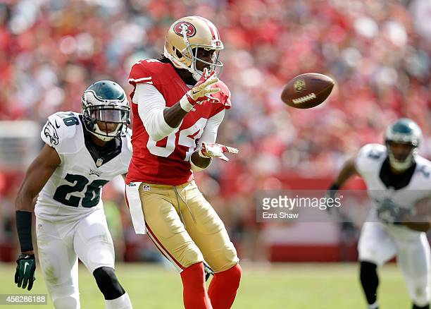 Brandon Lloyd of the San Francisco 49ers catches a ball while covered by Cary Williams of the Philadelphia Eagles at Levi's Stadium on September 28...
