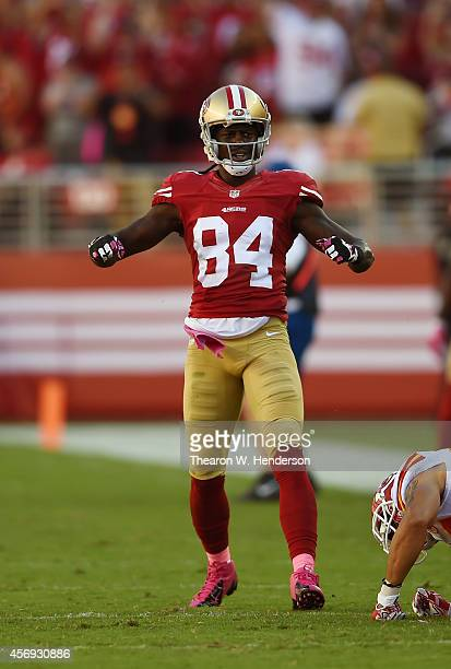Brandon Lloyd of the San Francisco 49ers celebrates after catching a twenty nine yard pass over Sean Smith of the Kansas City Chiefs during the...