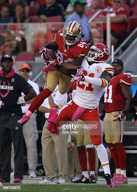 Brandon Lloyd of the San Francisco 49ers makes a catch while covered by Sean Smith of the Kansas City Chiefs at Levi's Stadium on October 5 2014 in...