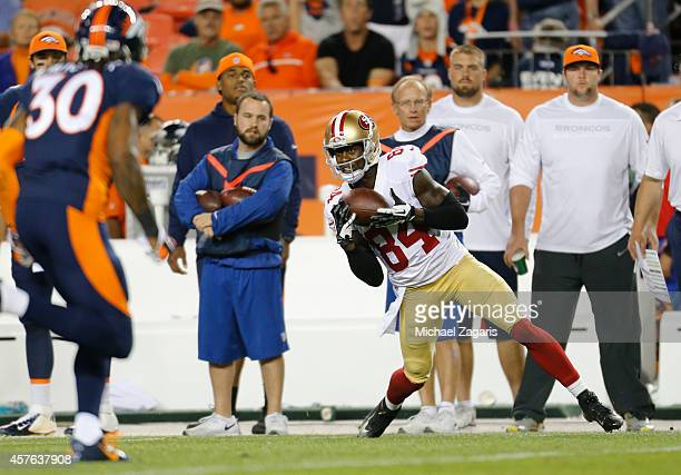 Brandon Lloyd of the San Francisco 49ers makes a reception during the game against the Denver Broncos at Sports Authority Field at Mile High on...