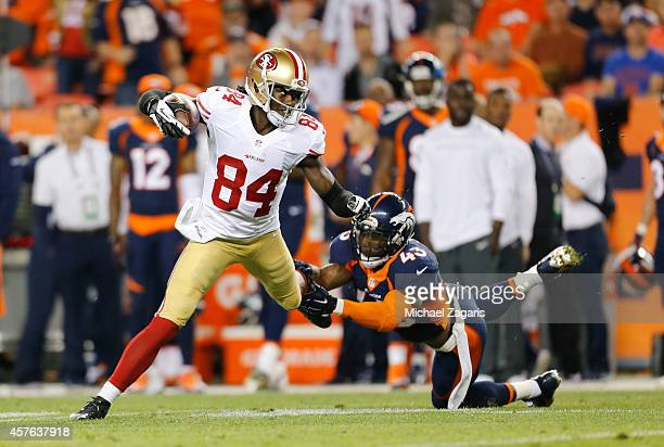 Brandon Lloyd of the San Francisco 49ers runs after making a reception during the game against the Denver Broncos at Sports Authority Field at Mile...