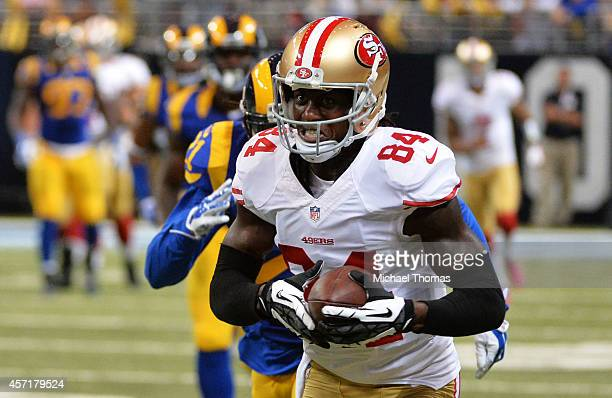 Brandon Lloyd of the San Francisco 49ers runs with a reception for an 80 yard touchdown in the second quarter against the St Louis Rams in the second...
