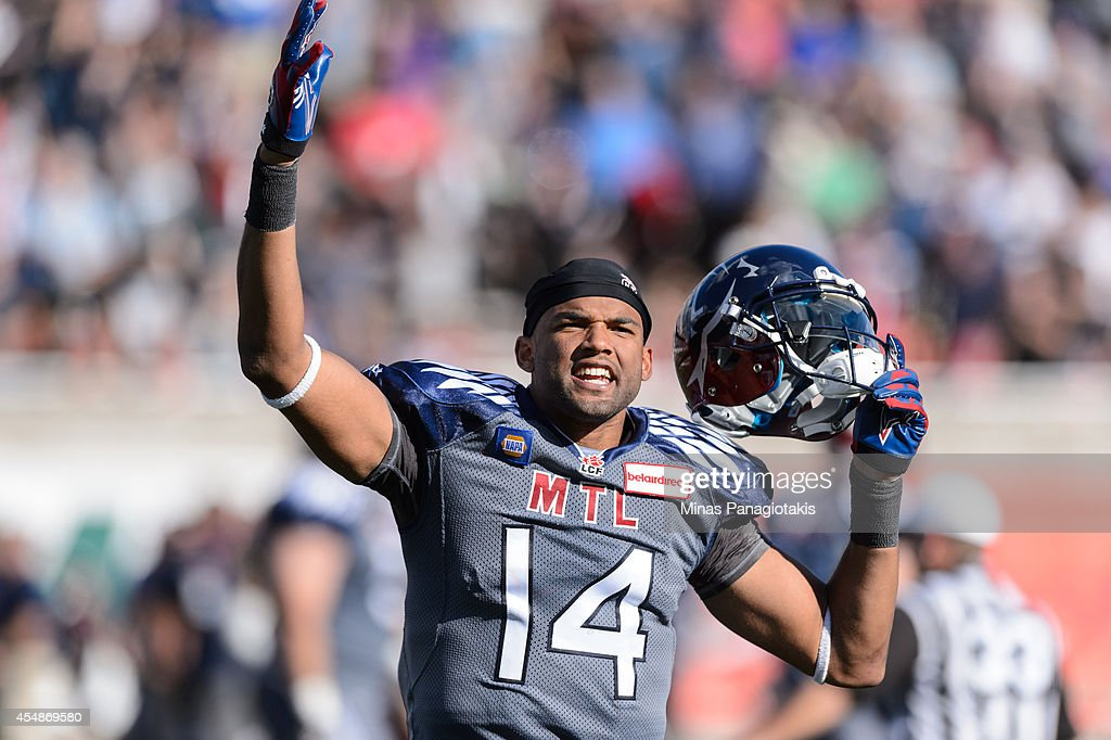 Brandon London #14 of the Montreal Alouettes celebrates a victory over the Hamilton Tiger-Cats during the CFL game at Percival Molson Stadium on September 7, 2014 in Montreal, Quebec, Canada. The Alouettes defeat the Tiger-Cats 38-31.