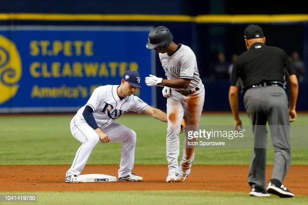 Brandon Lowe of the Rays tags Andrew McCutchen of the Yankees out after McCutchen's slide came up short during the MLB regular season game between...