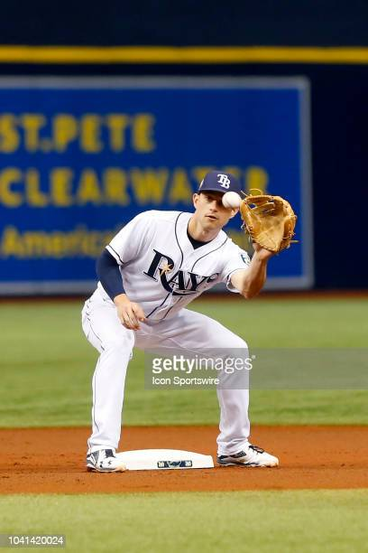 Brandon Lowe of the Rays waits for the throw down before tagging out Andrew McCutchen of the Yankees during the MLB regular season game between the...