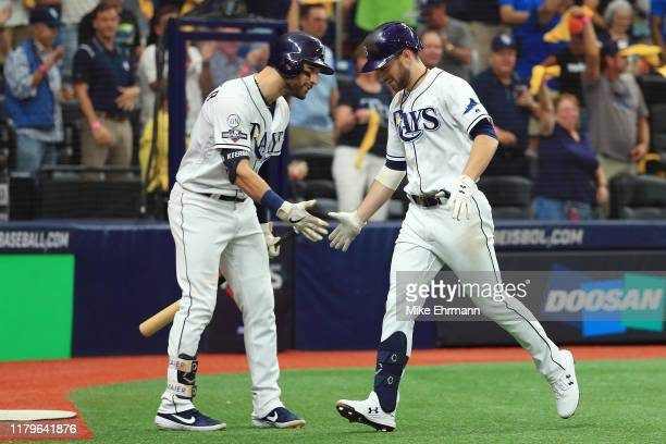 Brandon Lowe of the Tampa Bay Rays celebrates with Kevin Kiermaier after hitting a solo home run in the fourth inning against the Houston Astros in...