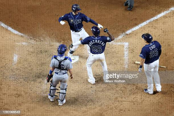 Brandon Lowe of the Tampa Bay Rays is congratulated by Ji-Man Choi and Randy Arozarena after hitting a three run home run against the Los Angeles...