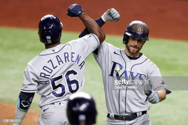 Brandon Lowe of the Tampa Bay Rays is congratulated by Randy Arozarena after hitting a two run home run against the Los Angeles Dodgers during the...