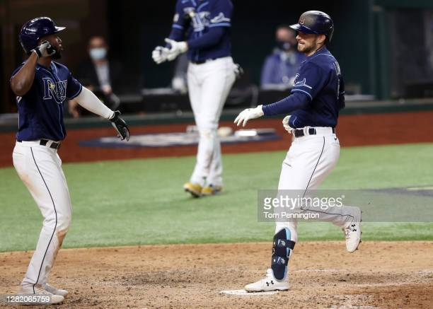 Brandon Lowe of the Tampa Bay Rays is congratulated by Randy Arozarena of the Tampa Bay Rays after hitting a three run home run against the Los...